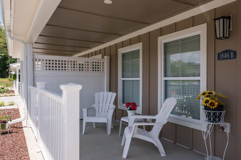 An apartment with covered patio seating at Legacy Living Florence in Florence, Kentucky