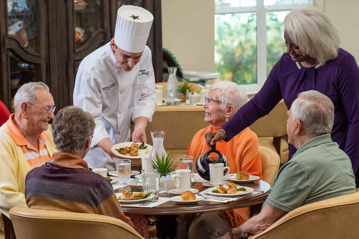 Residents of Hawthorn Senior Living in Vancouver, Washington being served a meal