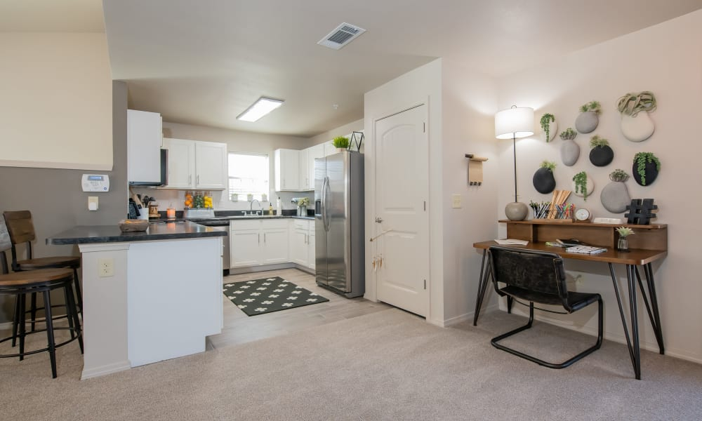 Open kitchen, and bar near office in loft  at Portico at Friars Creek Apartments in Temple, Texas
