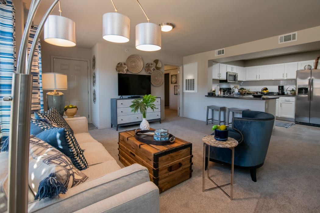 Living room and kitchen at Portico at Friars Creek Apartments in Temple, Texas