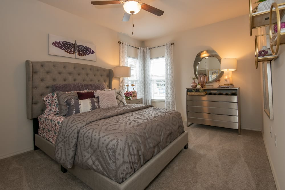 Master bedroom at Bend at New Road Apartments in Waco, Texas