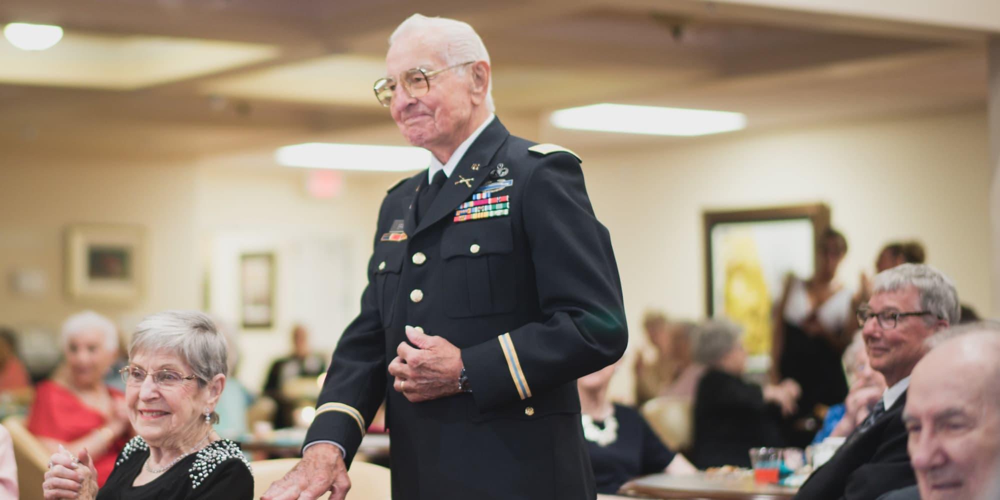 A veteran resident being recognized at Cottonwood Estates Gracious Retirement Living in Alpharetta, Georgia