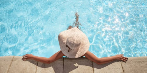 A tenant relaxing in a pool at Terrene at the Grove in Wilsonville, Oregon