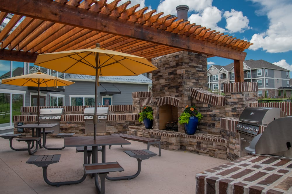 Outdoor grill and lounge seating at Cottages at Crestview in Wichita, Kansas