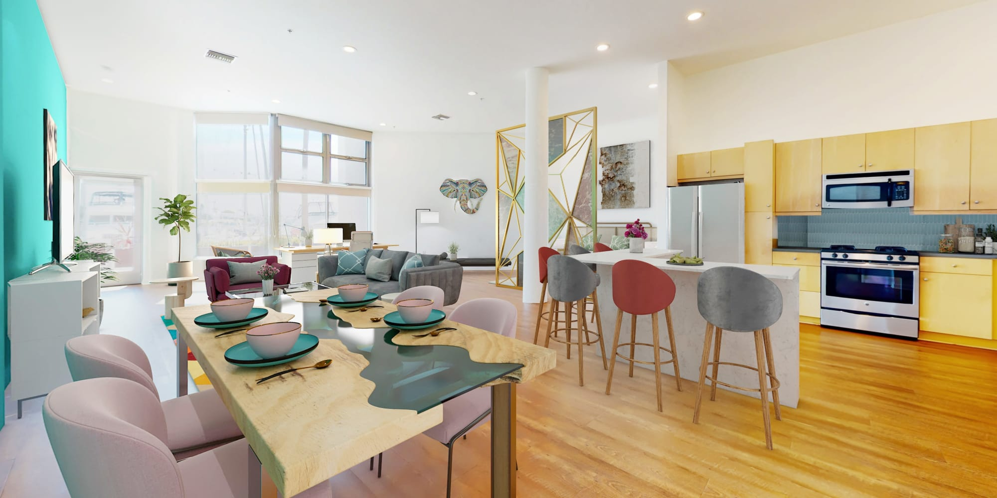 Spacious loft apartment's dining room, modern kitchen with stainless steel appliances, and hardwood floors at Esprit Marina del Rey in Marina Del Rey, California