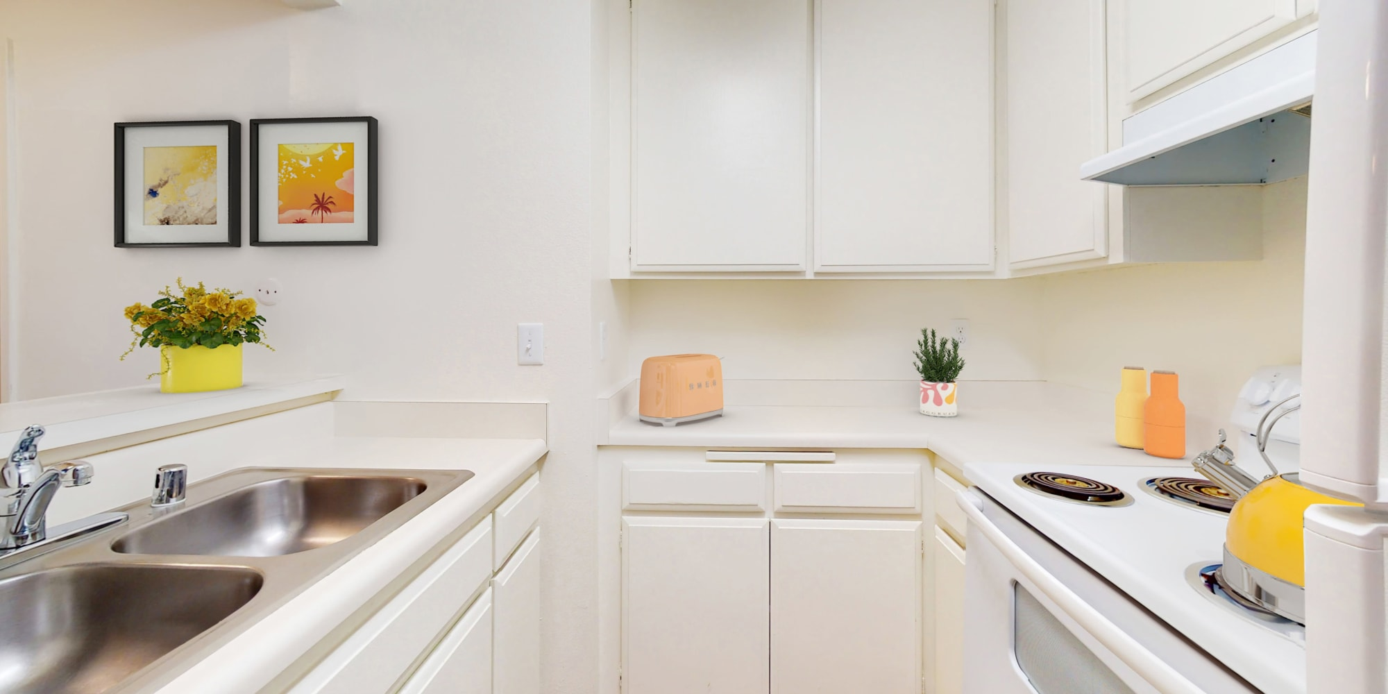 Kitchen with a dual-basin sink in a model apartment at Village Pointe in Northridge, California