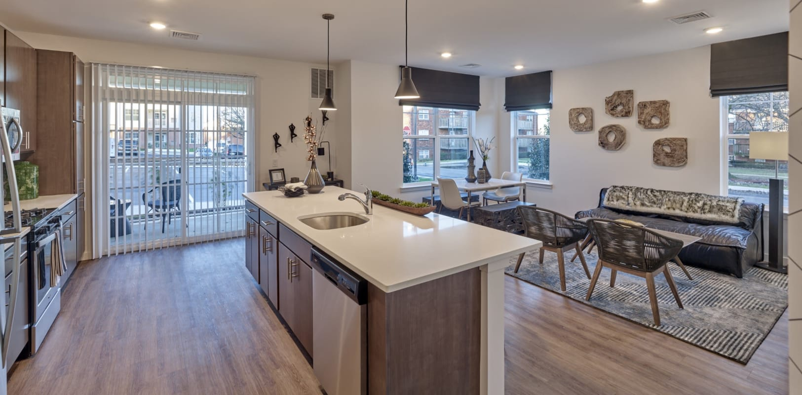 A kitchen island and a sliding glass door to the patio of a model home at The Mills at Lehigh in Bethlehem, Pennsylvania
