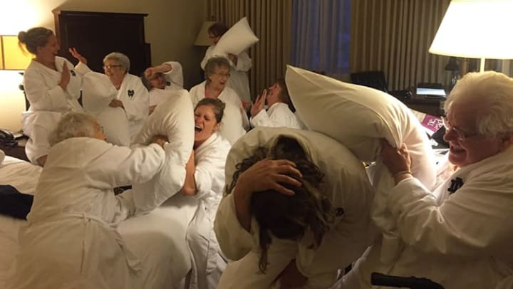 Residents having a pillow fight at Trilogy