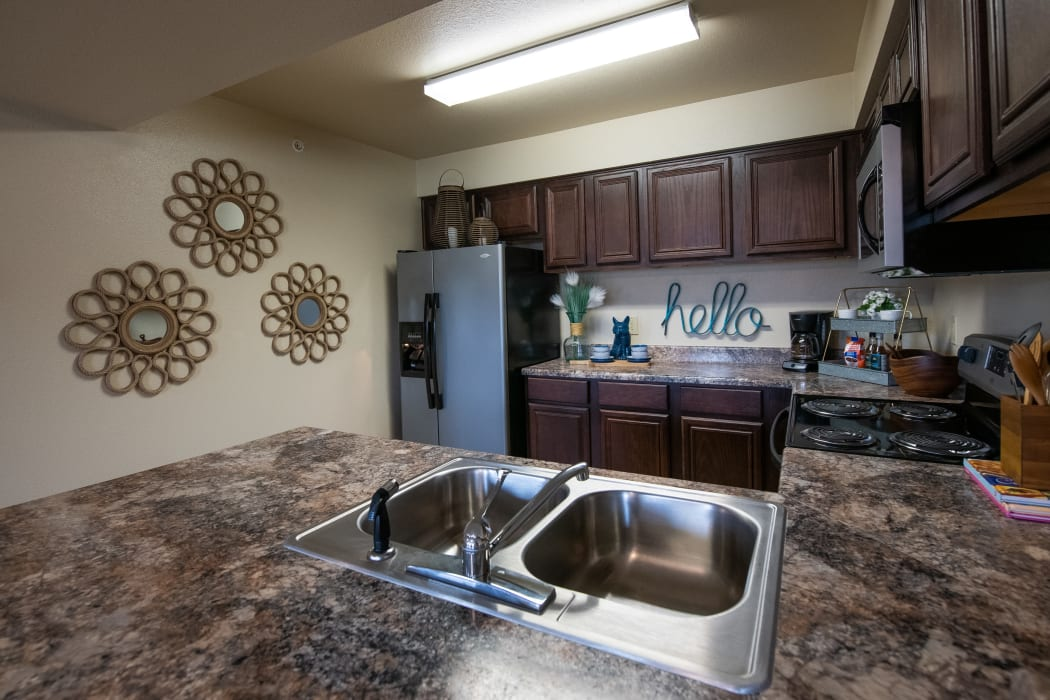 Beautiful counter tops in kitchen at Park at Mission Hills in Broken Arrow, Oklahoma