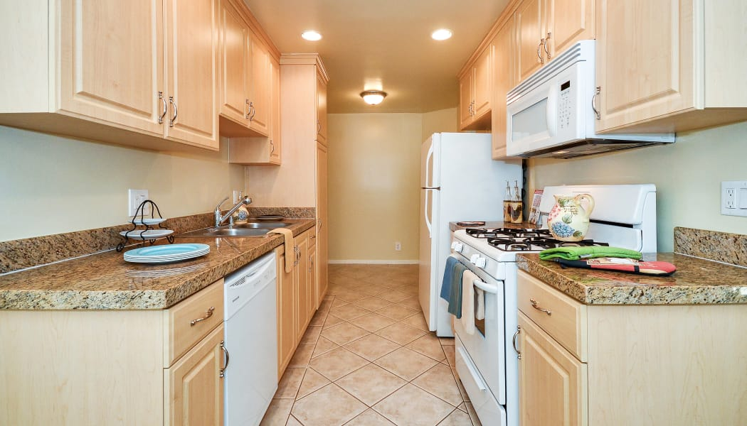 Gourmet kitchen with granite countertops in model home at IMT Beverly Arnaz in Los Angeles, CA