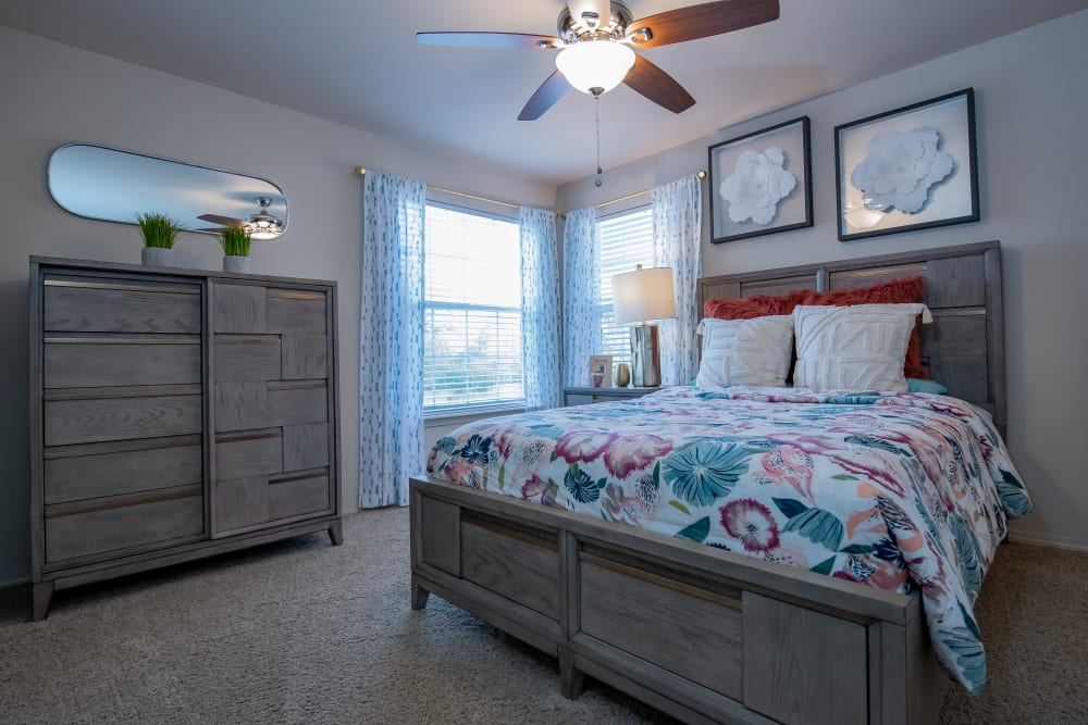 Bright bedroom with large windows at Nickel Creek Apartments in Tulsa, Oklahoma