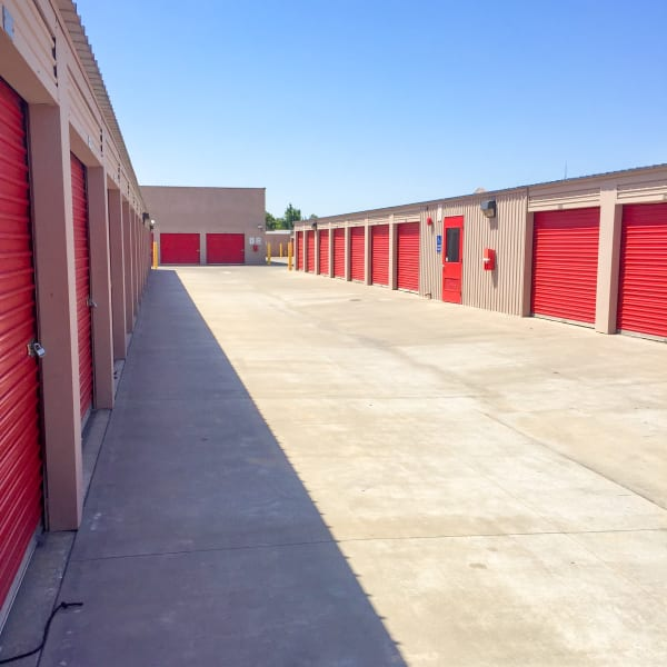 Outdoor storage units with red doors at StorQuest Self Storage in Stockton, California