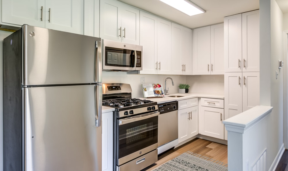 Beautiful bright cabinets with brushed metal finishes at Capital Crossing in Suitland, Maryland