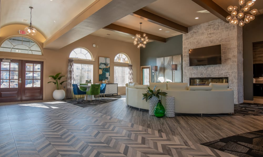 Spacious clubhouse with LED fireplace  at Portico at Friars Creek Apartments in Temple, Texas