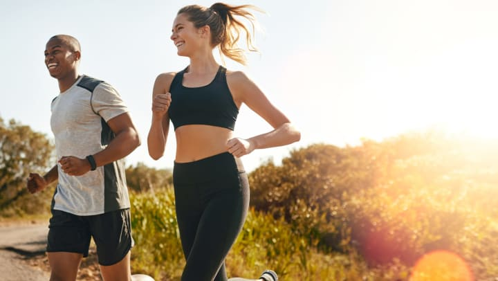 A young couple going for a run outdoors.