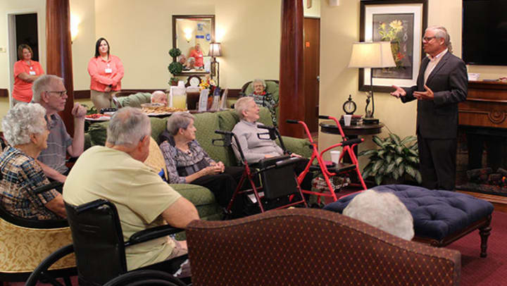 Senator Alting speaks in front of Cumberland Pointe senior living residents.