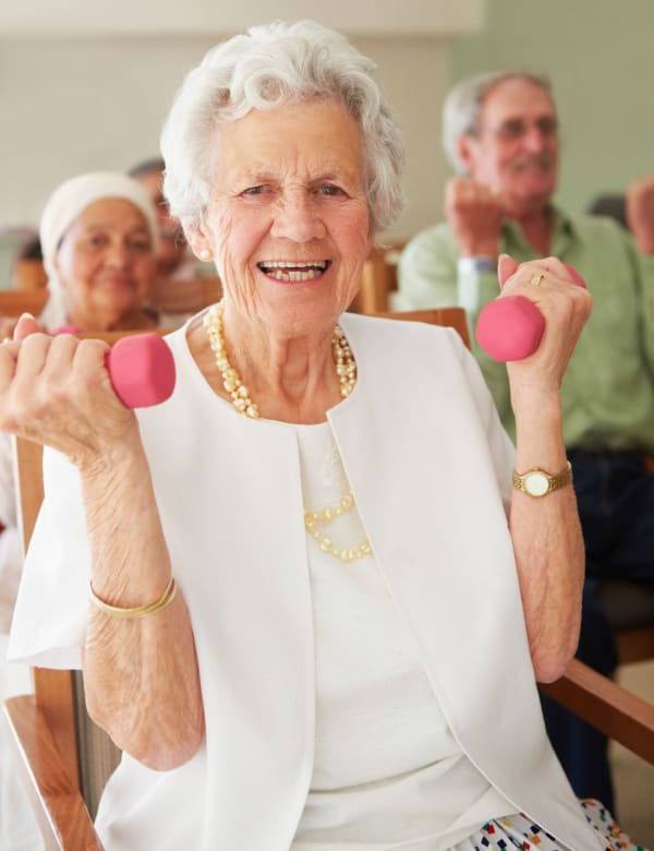 Woman exercising with weights at The Pearl at Eastside in Greenville, South Carolina
