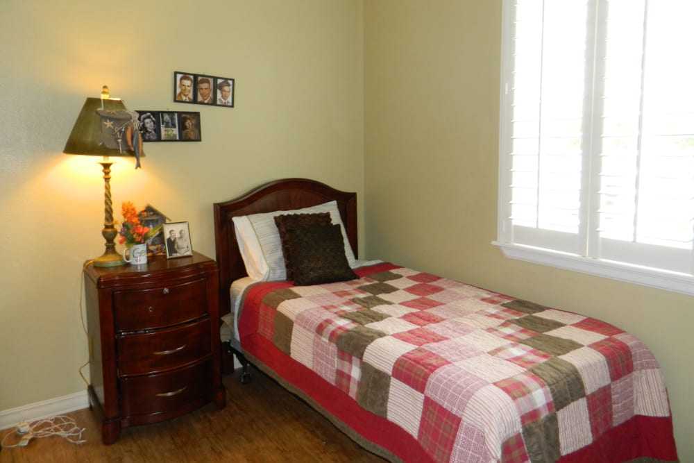 A furnished bedroom at Autumn Grove Cottage at Humble in Humble, Texas