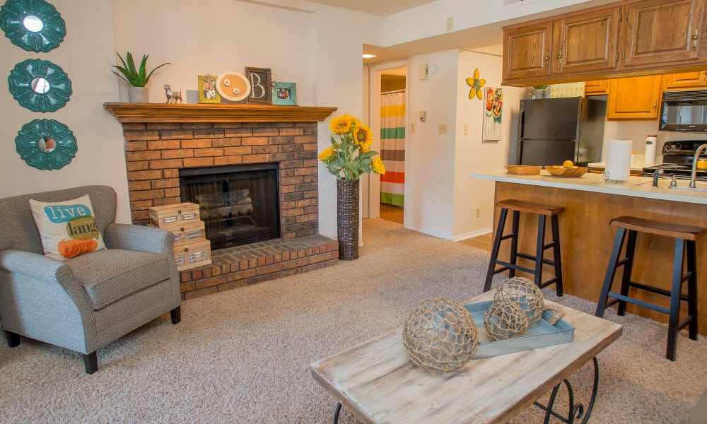 Living room with fireplace at Barrington Apartments in Tulsa, Oklahoma