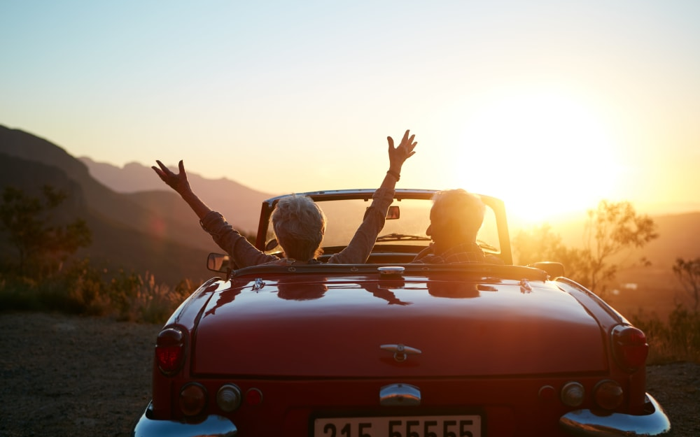 Independent living residents enjoying the sunset from their convertible near Palo Alto Commons in Palo Alto, California