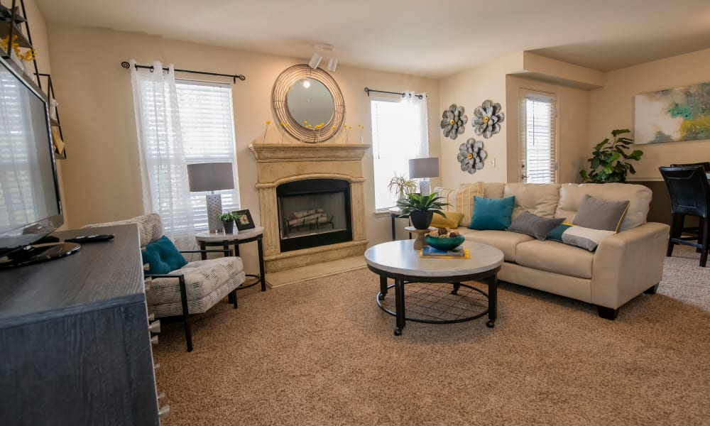 Large living room with many windows and patio at Park at Mission Hills in Broken Arrow, Oklahoma