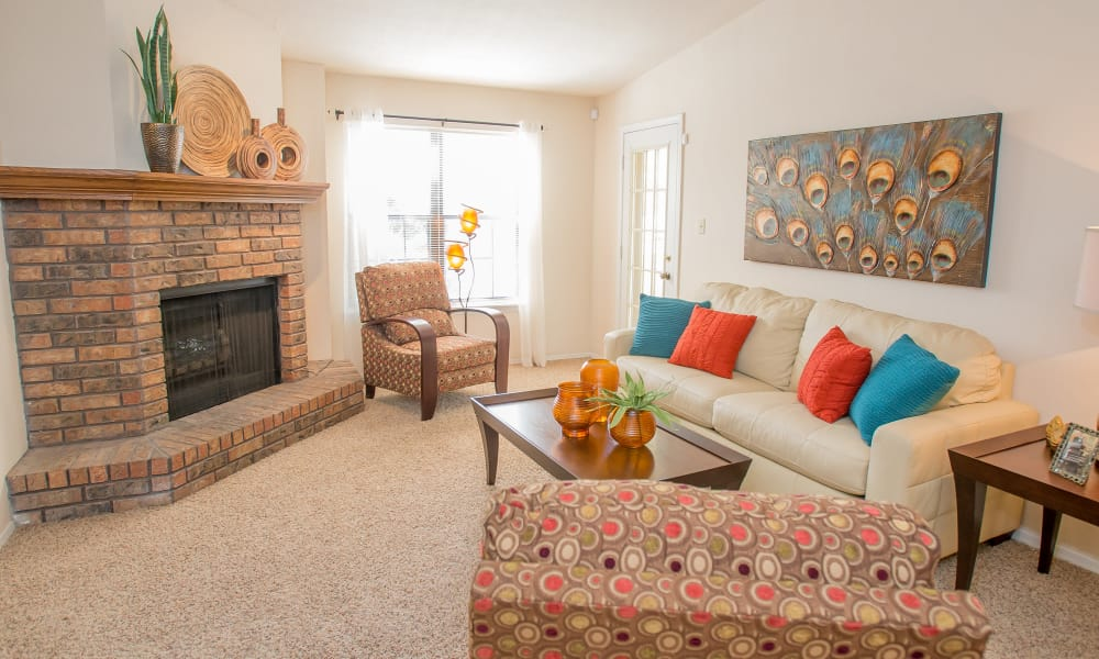 Living area with fireplace at Barrington Apartments in Tulsa, Oklahoma