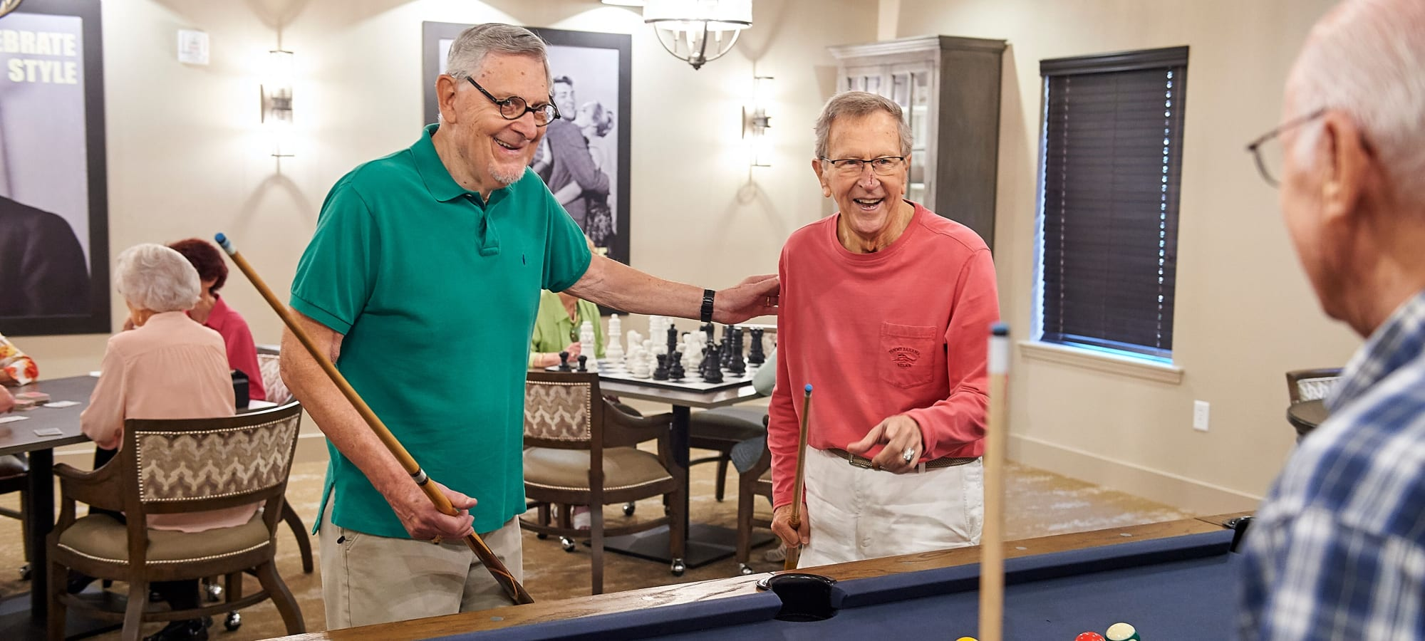 Residents playing pool at AgeWell Living