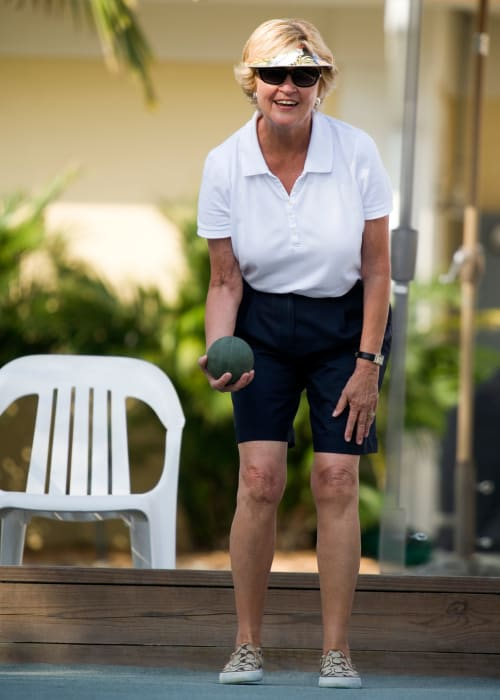 Resident playing bocce ball at Artistry at Craig Ranch in McKinney, Texas