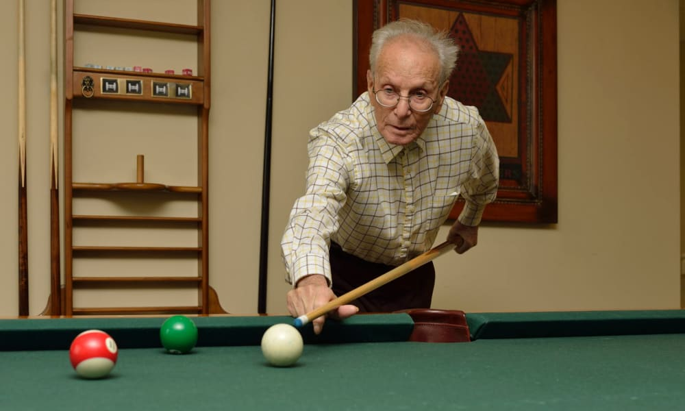 A resident playing billiards at Keystone Commons in Ludlow, Massachusetts