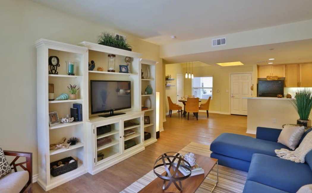 Well-decorated living area in a model home's open-concept floor plan at IMT Park Encino in Encino, California