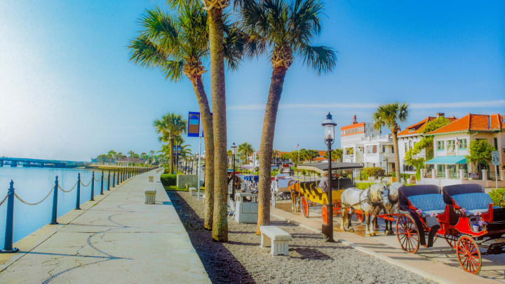 Horse drawn carriages on along the waterfront in St. Augustine, Florida, in a photo on our blog at The Enclave in Brunswick, Georgia