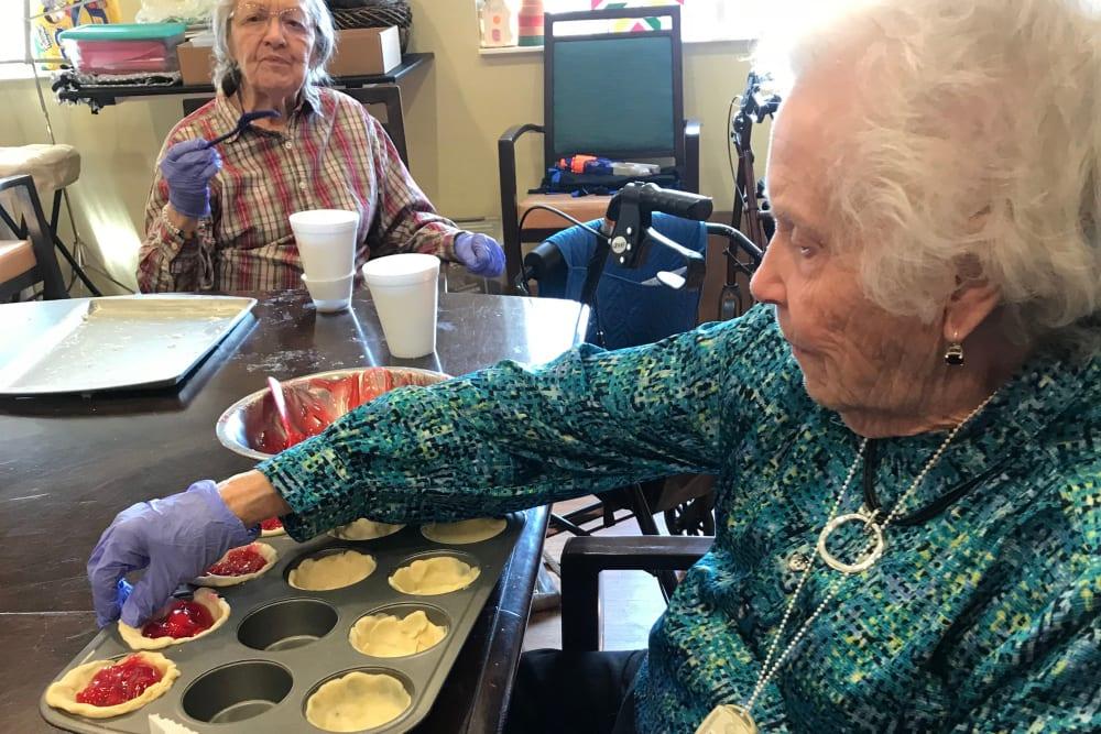 Resident baking at Edencrest at Siena Hills in Ankeny, Iowa