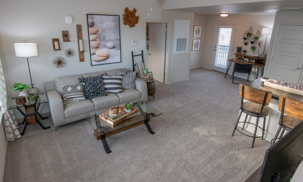 Living room with a view of the kitchen at Stonehorse Crossing Apartments in Oklahoma City, Oklahoma