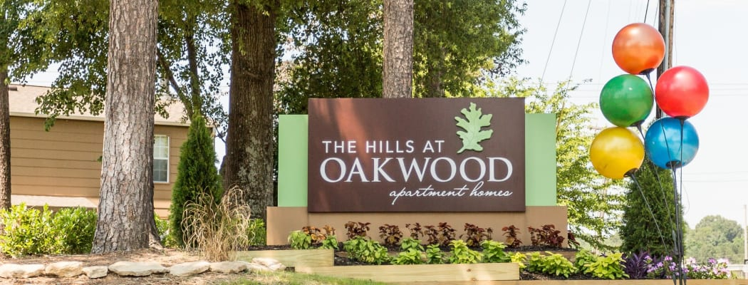 Memorial sign outside The Hills at Oakwood Apartment Homes in Chattanooga, Tennessee