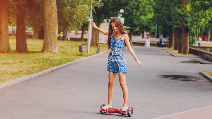 Resident learning to ride a self-balancing transporter near Olympus Sierra Pines in The Woodlands, Texas