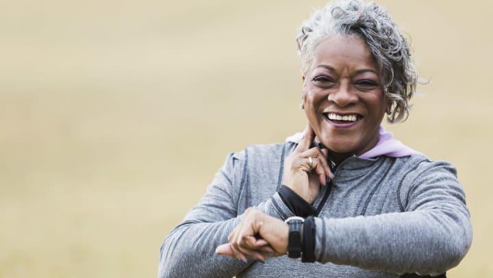 Senior woman taking heart rate