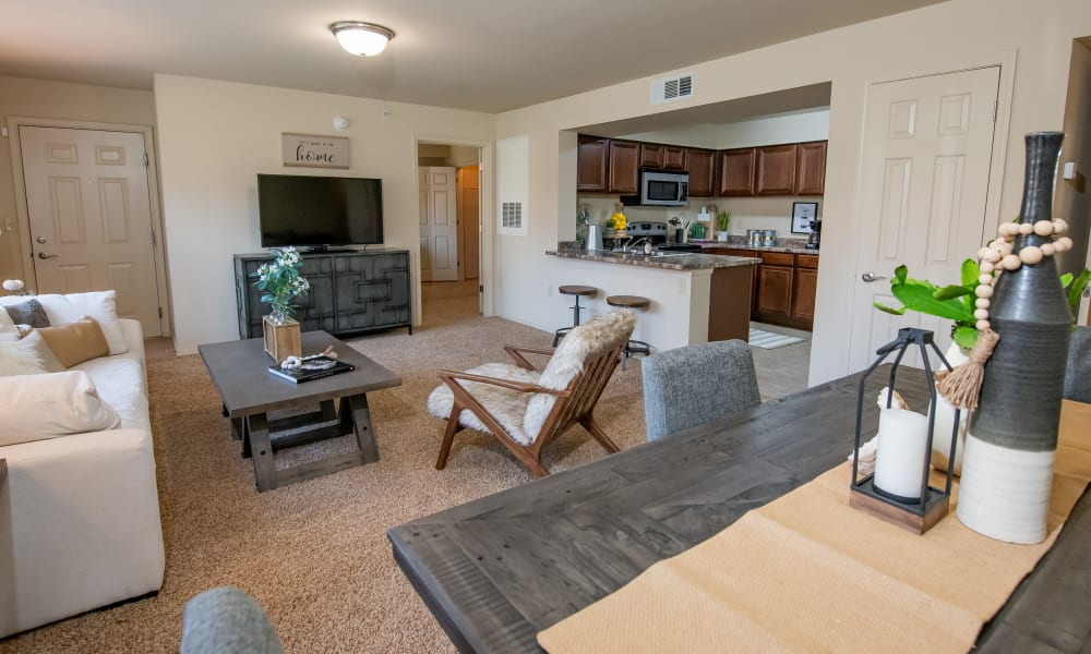 Living room, dining area and open kitchen areas at Coffee Creek Apartments in Owasso, Oklahoma