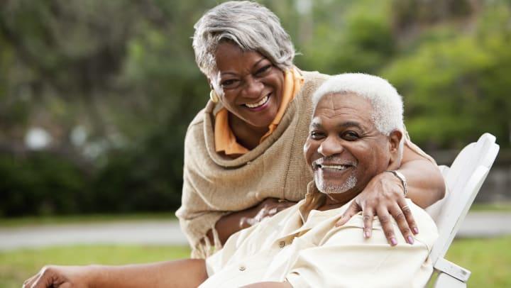 Senior Couple Outside Smiling