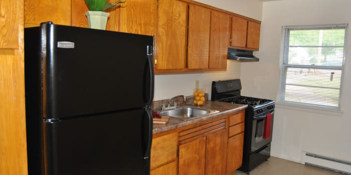 Modern kitchen at Village Green Apartment Homes