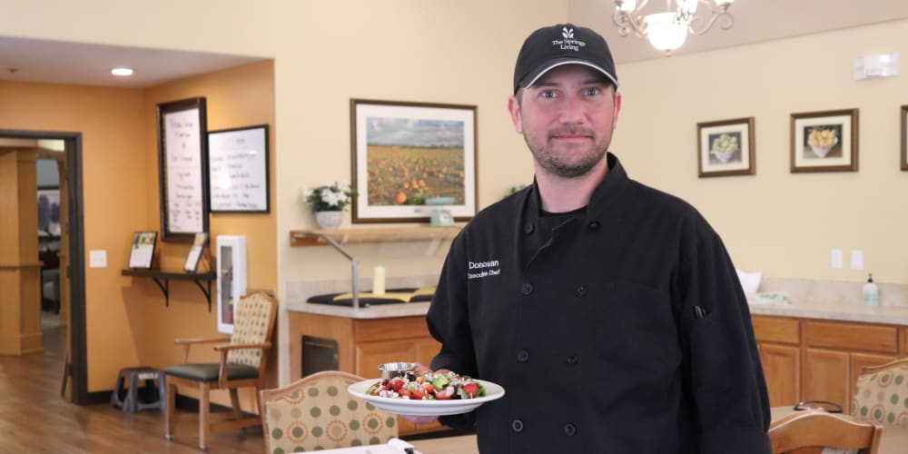 Chef holding delicious salad at The Springs at Sunnyview in Salem, Oregon