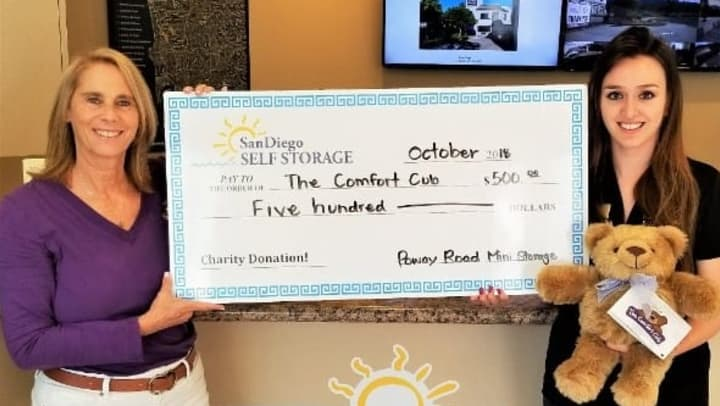 Poway Road Mini Storage presenting a check to Comfort Cubs