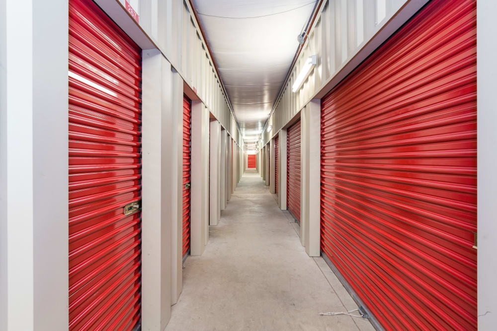 Indoor storage units with red doors at Stor 4 Dayz in Sanford, Florida
