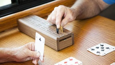 Residents playing cribbage at Mattison Crossing at Manalapan Avenue in Freehold, New Jersey