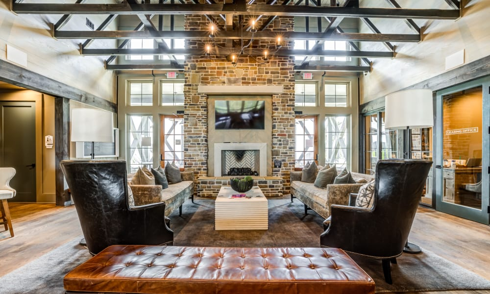 Interior clubhouse with fireplace and seating  area at Rivertop Apartments in Nashville, Tennessee