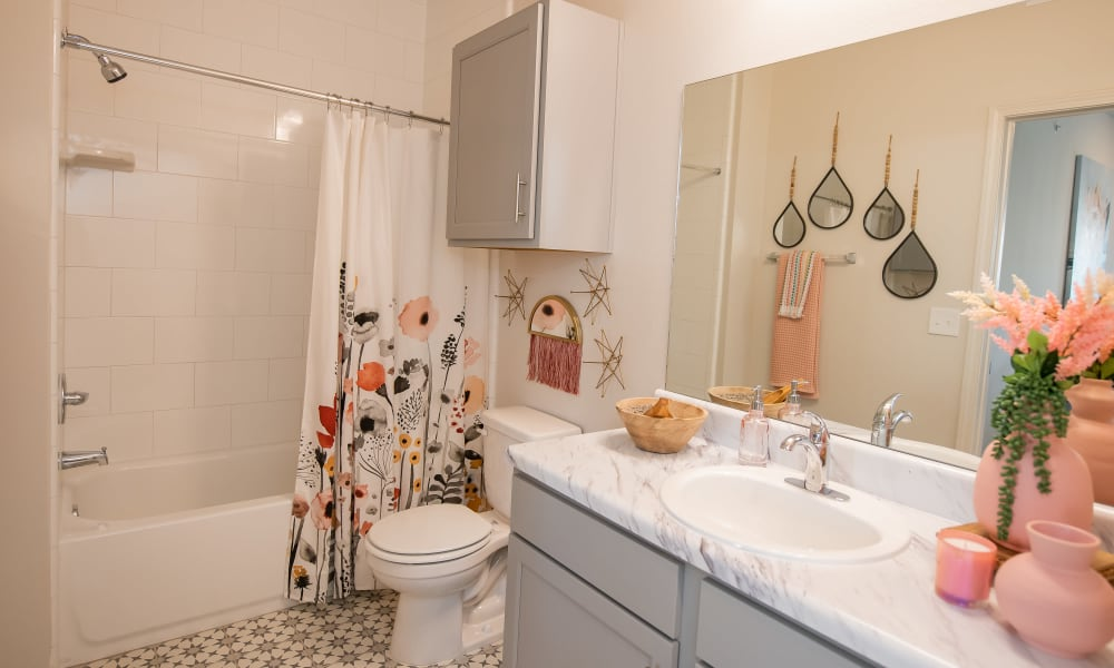 Cute bathroom with large mirror at Artisan Crossing in Norman, Oklahoma