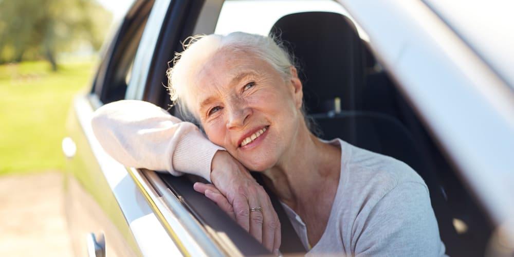 Senior driving in car at The Commons at Elk Grove in Elk Grove, California