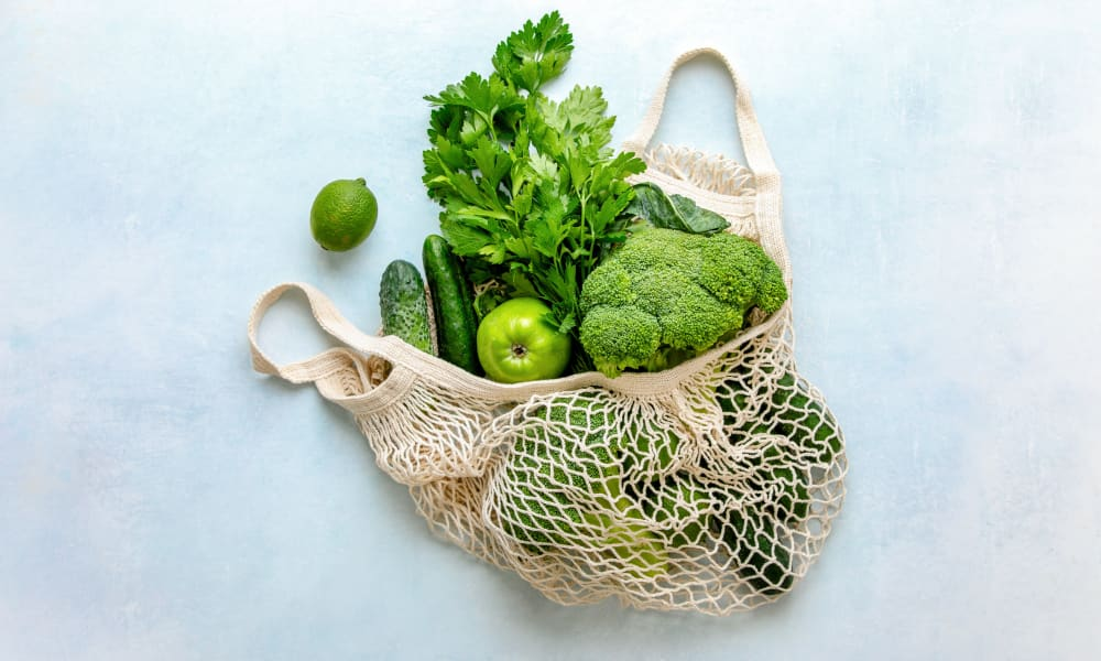 Reusable produce bag fulled with fresh vegetables at The Buckler in Milwaukee, Wisconsin