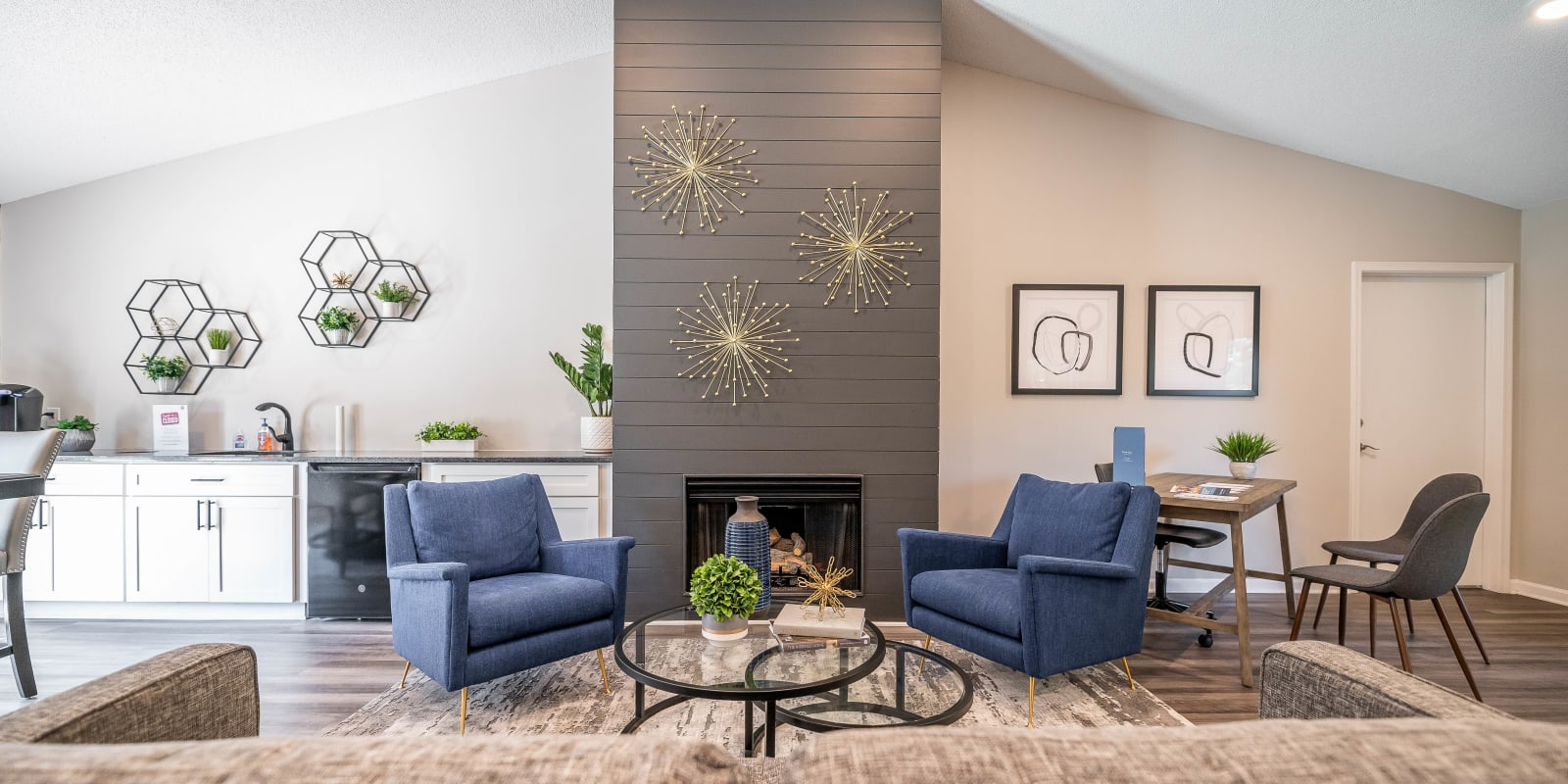 Spacious clubhouse with comfortable seating at Kannan Station Apartment Homes in Kannapolis, North Carolina