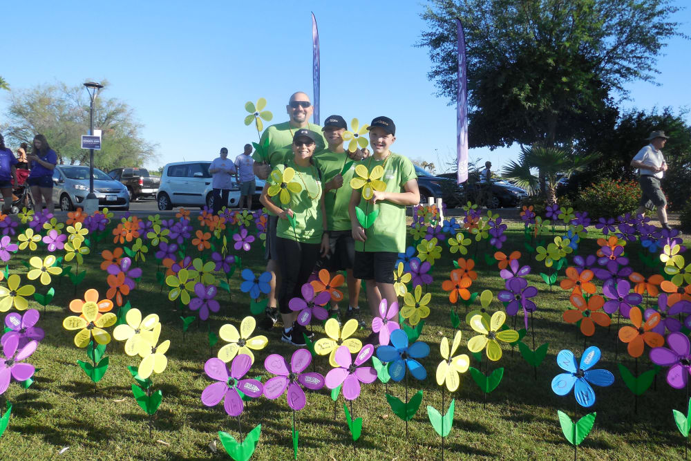 Team members and residents at The Alzheimer's Walk near The Groves, A Merrill Gardens Community in Goodyear, Arizona.