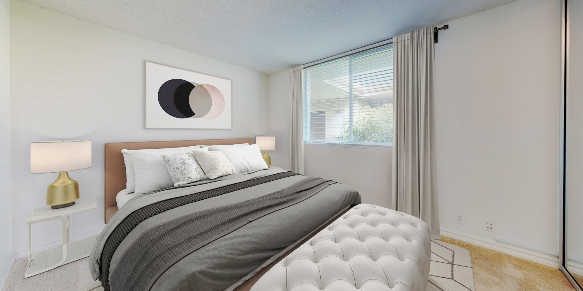 Bedroom in a two-bedroom apartment home at Sunset Barrington Gardens in Los Angeles, California